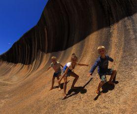 Kids catching Wave Rock