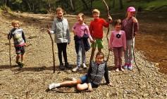The kids enjoying the river