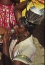 Pol Kadum metal milk jugs are carried on the head