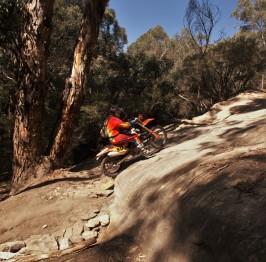 Trail bikes climbing the rock